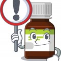 A,Cartoon,Icon,Of,Antibiotic,Bottle,With,A,Exclamation,Sign