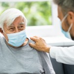 Doctor,Talking,To,Elderly,Patient,At,Home