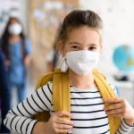 Child,With,Face,Mask,Going,Back,To,School,After,Covid-19
